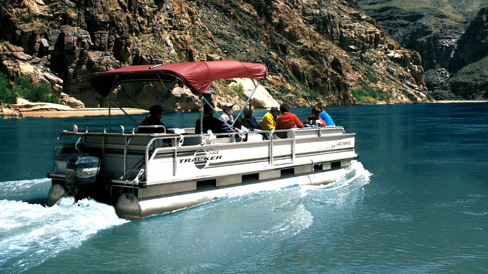 Passengers aboard a pontoon boat floating up the Colorado River at Grand Canyon West.