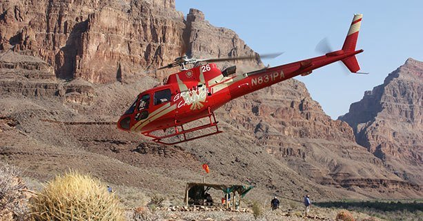 A helicopter making its descent to the bottom of the Grand Canyon West.