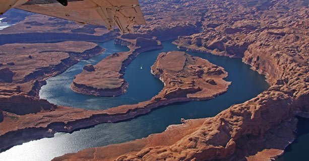 The twisting shoreline of Lake Powell as seen from an airplane.'