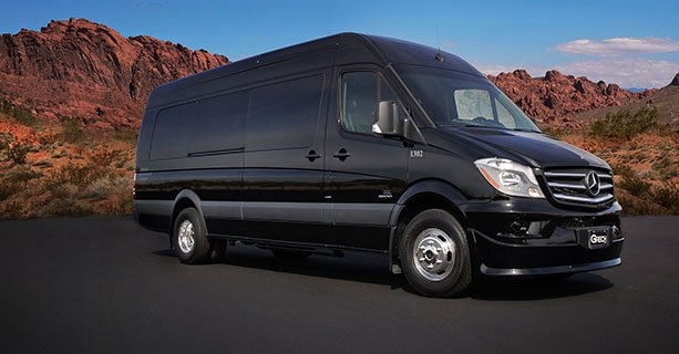 Image of one of our Sprinter tour vehicles with Nevada Red Rocks in the background
