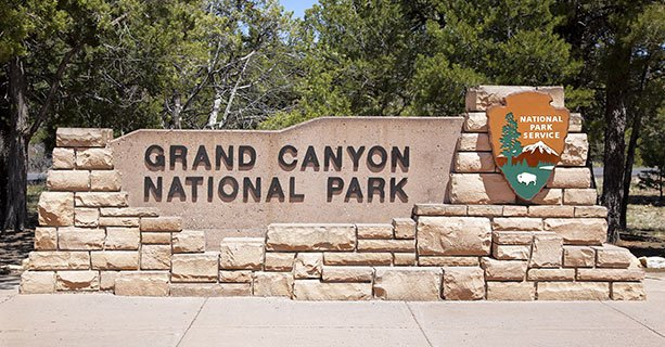 Stone sign that reads Grand Canyon National Park.