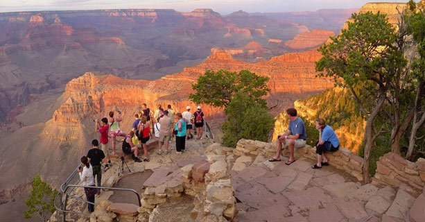 Guests on an overlook of the Grnad Canyon during Sunset'