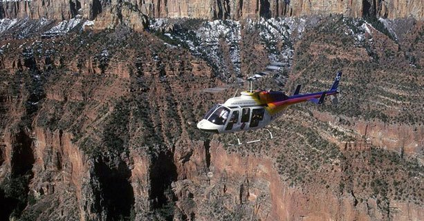 Bell helicopter hovering over Grand Canyon National Park