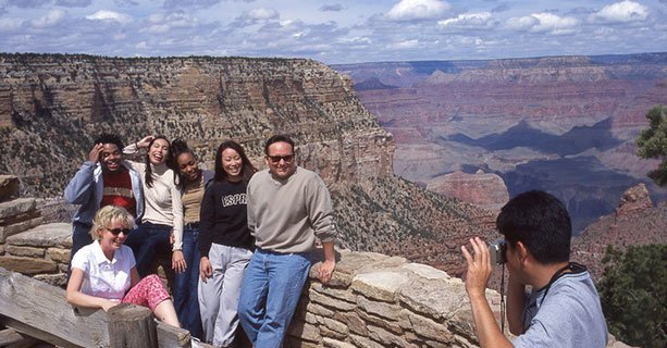 Guests having their picture taken on one of the Overlooks on the South Rim of the Grand Canyon