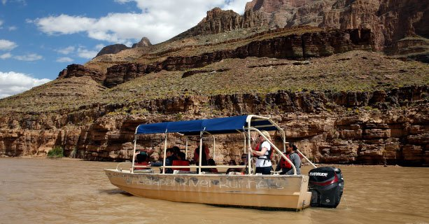 Passengers aboard a pontoon boat on the Colorado River.