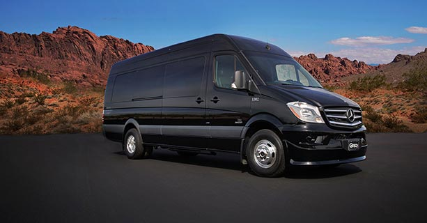 A black Sprinter vehicle parked in front of the Nevada desert scenery.