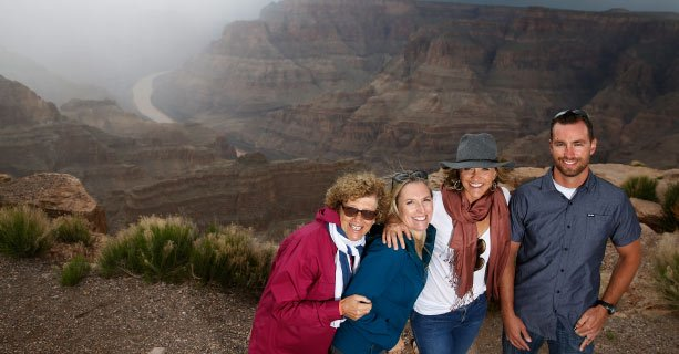 A group of guests having a picture taken on the West Rim of the Grand Canyon