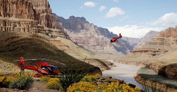 A helicopter lands on the floor of the Grand Canyon West.