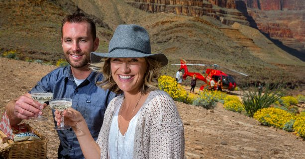 Helicopter passengers enjoy a champagne toast and picnic on the Grand Canyon floor.'