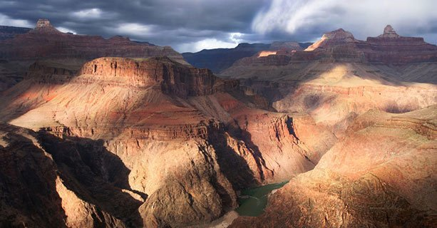 The sun casts shadows across the walls of the Grand Canyon.'