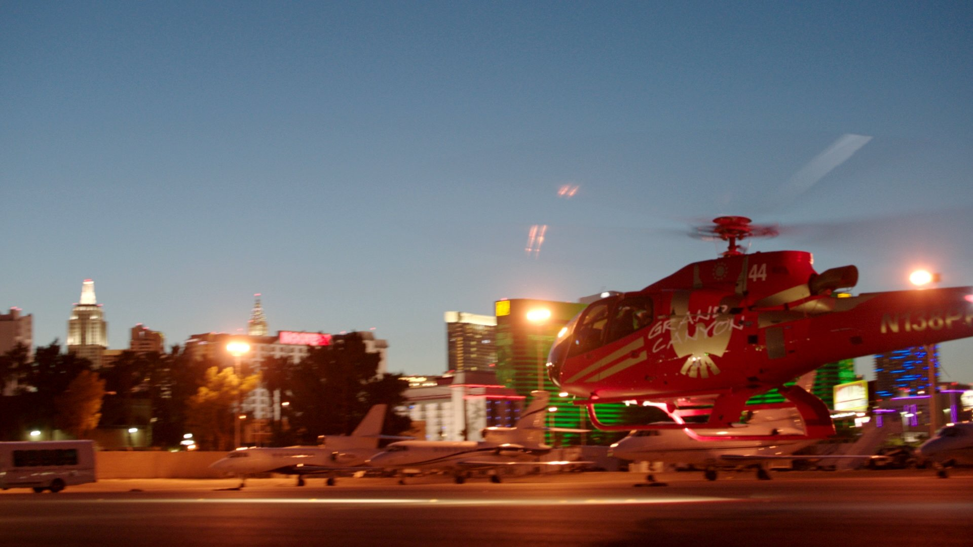 A helicopter setting off on a Las Vegas Strip tour at night.