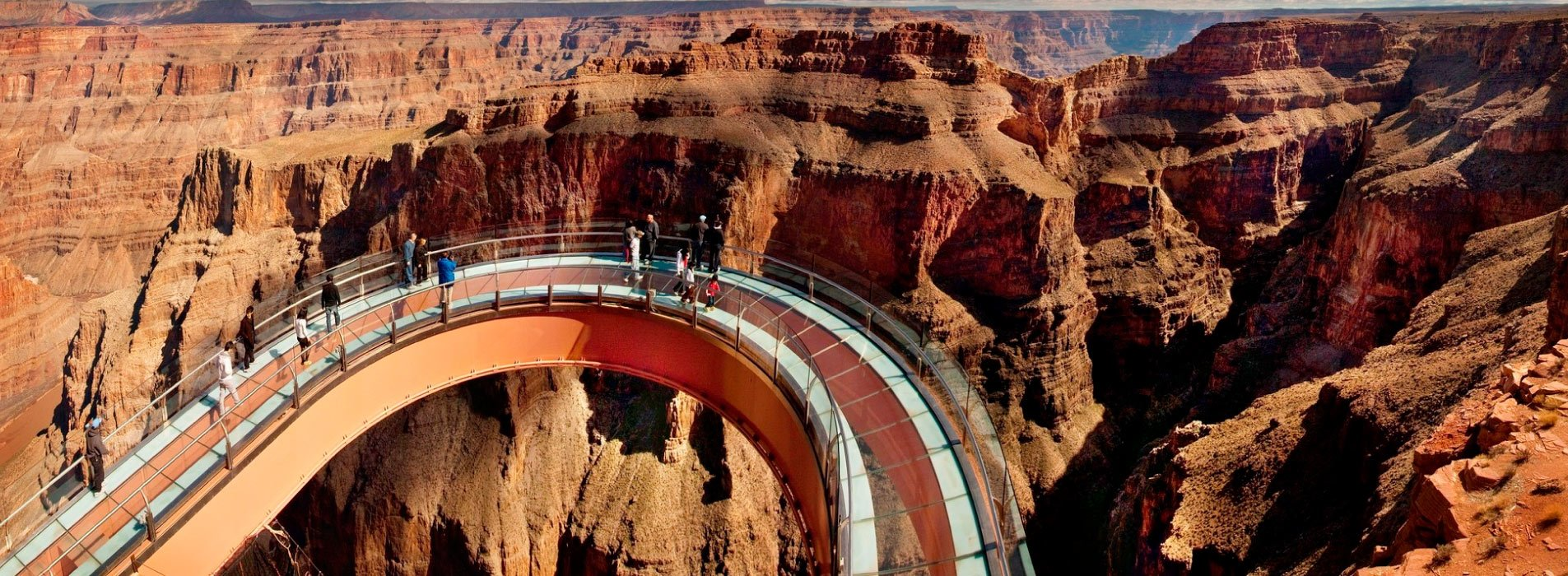 Guests standing on the Skywalk Bridge at the Grand Canyon West Rim.