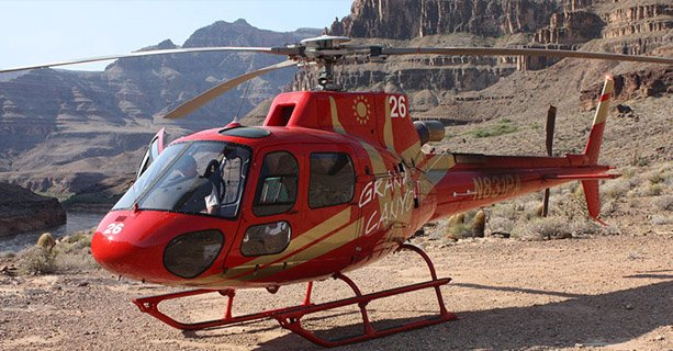 A helicopter landed on the Grand Canyon floor.