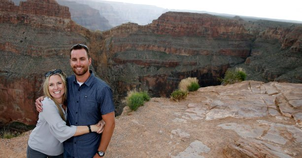 Sightseers pose for a picture at the edge of the Grand Canyon West.