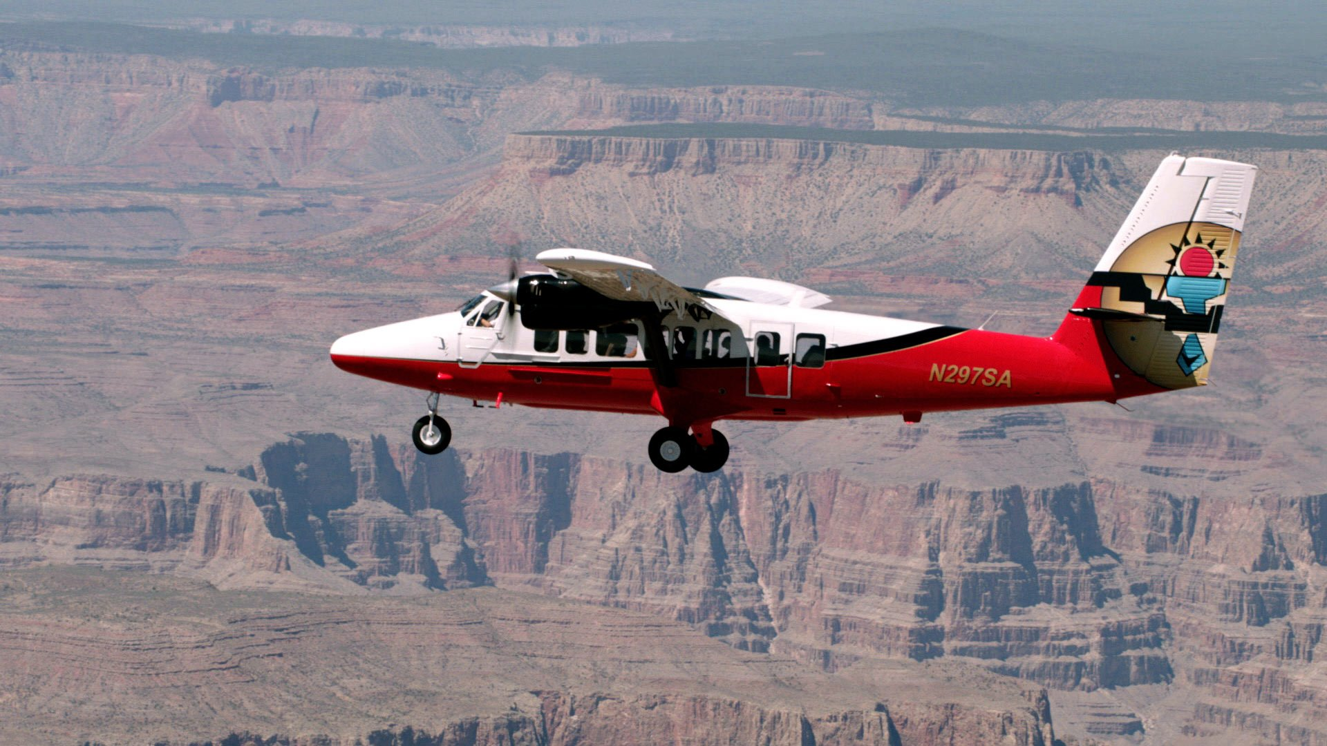Twin Otter plane flying over the Grand Canyon on a South Rim airplane tour. Tour departing from South Rim
