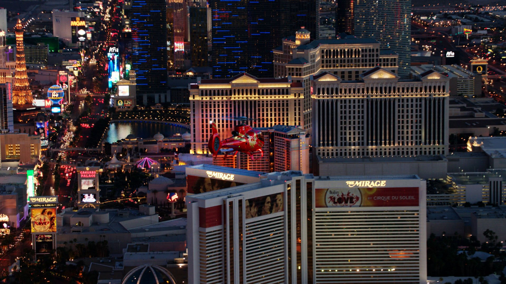 EC-130 red helicopter flying over the Las Vegas Strip
