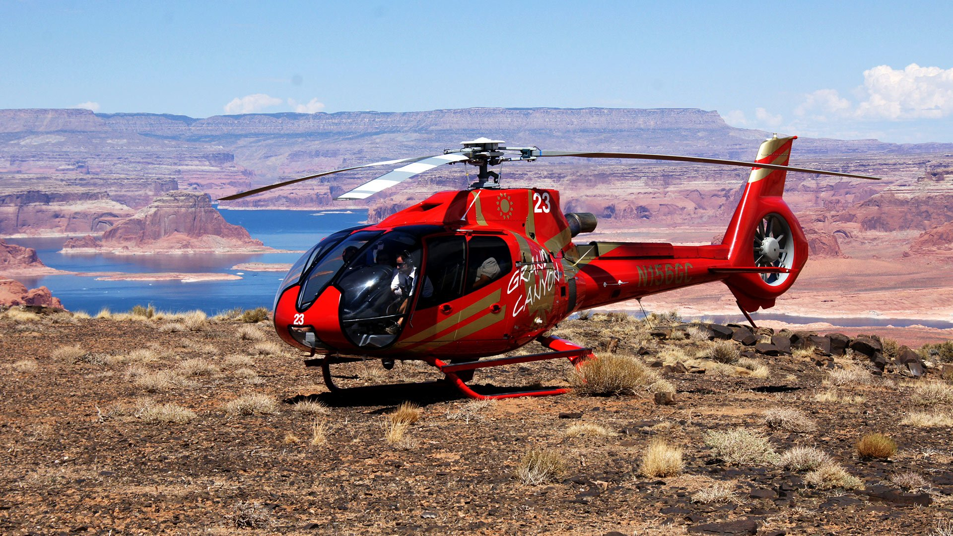 EC-130 landed atop Tower Butte with Lake Powell in the background. Page, AZ Helicopter Tours