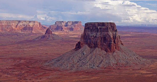 Tower Butte, with the vast desert expanse in the background.'