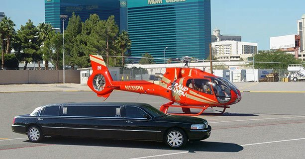 A limousine and helicopter with the Las Vegas Strip in the background.