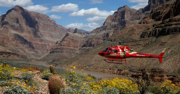 A helicopter makes a descent to the floor of the Grand Canyon West.
