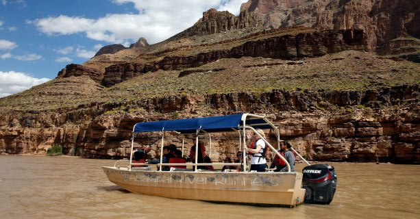 A pontoon boat cruises down the Colorado River.