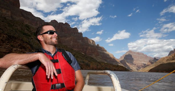 Passenger aboard a pontoon boat on the Colorado River.