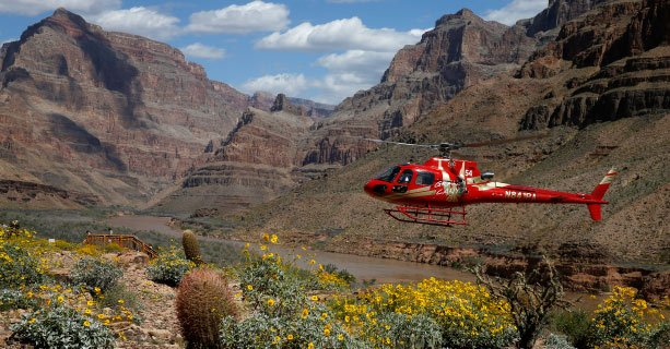 A helicopter descends to the floor of the Grand Canyon.