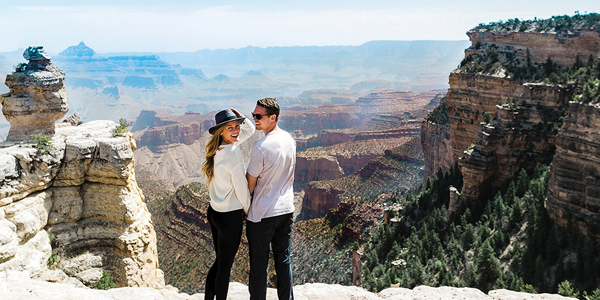 A couple poses at the Grand Canyon National Park. Flight departing our South Rim terminal.